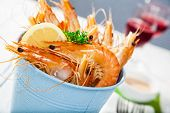 Bucket Of King Prawns On Ice