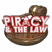 Piracy and the Law words on a judge's gavel for judgement against a criminal guilty of illegal downl