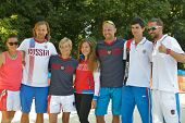 MOSCOW, RUSSIA - JULY 20, 2014: Team Russia celebrates the 3rd place in ITF Beach Tennis World Team Championship. In the match for the 3rd place Russia beat Germany 3-0