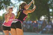 MOSCOW, RUSSIA - JULY 19, 2014: Dorothee Berreth (in front) and Carina Blank of Germany in the match against Brazil during ITF Beach Tennis World Team Championship. Brazil won 2-1