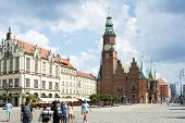 POLAND, WROCLAW - AUGUST 3: Tourists visit the Old Market Square and gothic Town Hall on 3 August 20