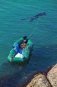 Rapan Catcher With Boat. Black Sea Coast, Bulgaria