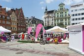 WROCLAW, POLAND - AUGUST 3: People on the beach in the center of the Old Town on the Salt Square as