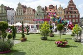 WROCLAW, POLAND - AUGUST 3: People on the beach in the center of the Old Town on the Salt Square as part of New Horizons Cinema, Poland's Largest Art House Cinema on 3 August 2014 in Wroclaw, Poland.