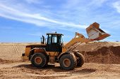image of oversize load  - Yellow Bulldozer at Construction irrigation canal in Desert  - JPG