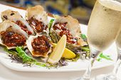 stock photo of oven  - Delicious oven baked oysters kilkpatrick with champagne - JPG