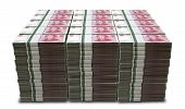 image of yuan  - A pile of stacked wads of Chinese yuan banknotes on an isolated background - JPG