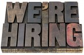 we are hiring - isolated words in vintage letterpress wood type with ink patina