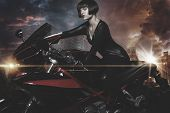 Rebel city, Sensual and Beautiful brunette woman on a motorcycle