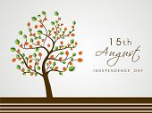 Tree with national tricolors leaves on grey background for 15th of August, Indian Independence Day c