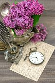 Lilac Flowers And Old Post Mail On Wooden Background