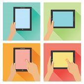 Hand holding tablet flat design