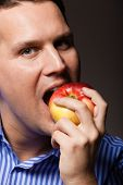 Diet Nutrition. Happy Man Biting Apple Fruit