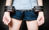 Leather Handcuffs On Prisoner Girl