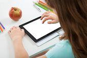 Schoolgirl Using Digital Tablet With Blank Screen
