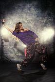 Modern hip-hop dancer over grunge background.
