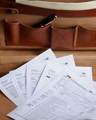 Tax Forms In A Leather Briefcase- Vertical
