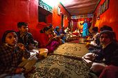 KATHMANDU, NEPAL - DEC 9, 2013: Unknown children during the reading of texts in Sanskrit at Jagadgur