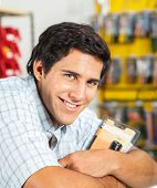 Portrait of handsome man smiling in hardware store