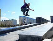 Nadym, Russia - May 17, 2008: Jumping On Board With A Springboard. Unknown Guy In A Jump From A Spri