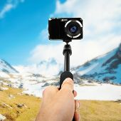 Taking Selfie - Hand Hold Monopod With Photo Camera