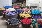 Pots With Colorful Yarns Dyed In The Old Workshop