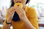 Woman Eat Donut