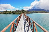 National Park Chile - Torres del Paine. Easy Bridge at Lake Pehoe connects the island and the shore of Lake
