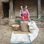 BHAKTAOUR, NEPAL - DEC 7, 2013: Unidentified Nepalese woman working in the pottery workshop. More 100 cultural groups have created an image Bhaktapur as Capital of Nepal Arts.