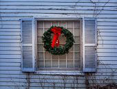 Traditional Xmas Wreath On Window