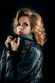 foto of jacket  - Studio portrait of blonde woman in leather biker jacket - JPG