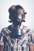 stock photo of gas mask  - little boy with gas mask for air pollution - JPG