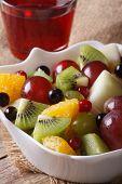 Fruit Salad And Grape Juice Close Up. Vertical