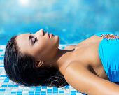 Beautiful woman in outdoor pool. Spa portrait.