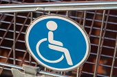 picture of wheelchair  - Wheelchair user diasbled sign on a shopping cart  - JPG