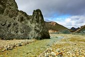 Green rock and creek in the gorge. National Park Landmannalaugar in Iceland