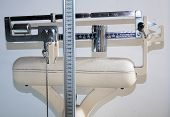 Old Bathroom Scale With Measuring Rod For The Height And The Weight Counterbalance