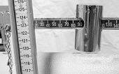 image of measuring height  - antique scale numbers with the meter to measure the weight and height of patients - JPG