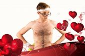 Geeky shirtless hipster posing with dumbbell against valentines heart design