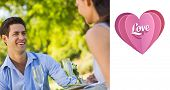 Couple with champagne flutes sitting at an outdoor caf�?�© against love heart