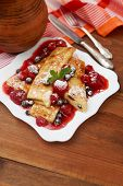 picture of crepes  - Tasty crepes on wooden table studio shot - JPG