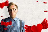 Geeky hipster covered in kisses against parchment