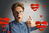 Geeky hipster covered in kisses against white background with vignette