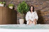foto of hot-tub  - Young woman relaxing in the hot tub - JPG