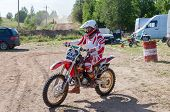 Unidentified Driver Racing After The Competition In Motocross