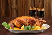 foto of roast duck  - Roasted duck with quince mint and red wine on wood background - JPG
