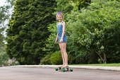 image of driveway  - Girl having fun skateboarding home driveway with dogs - JPG