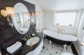 stock photo of tub  - View of bright bathroom in baroque style - JPG
