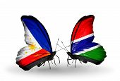 Two Butterflies With Flags On Wings As Symbol Of Relations Philippines And Gambia
