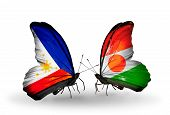 Two Butterflies With Flags On Wings As Symbol Of Relations Philippines And Niger